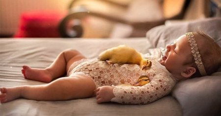The photographer takes pictures of newborn children, hugging animals, and the photos are beyond charming